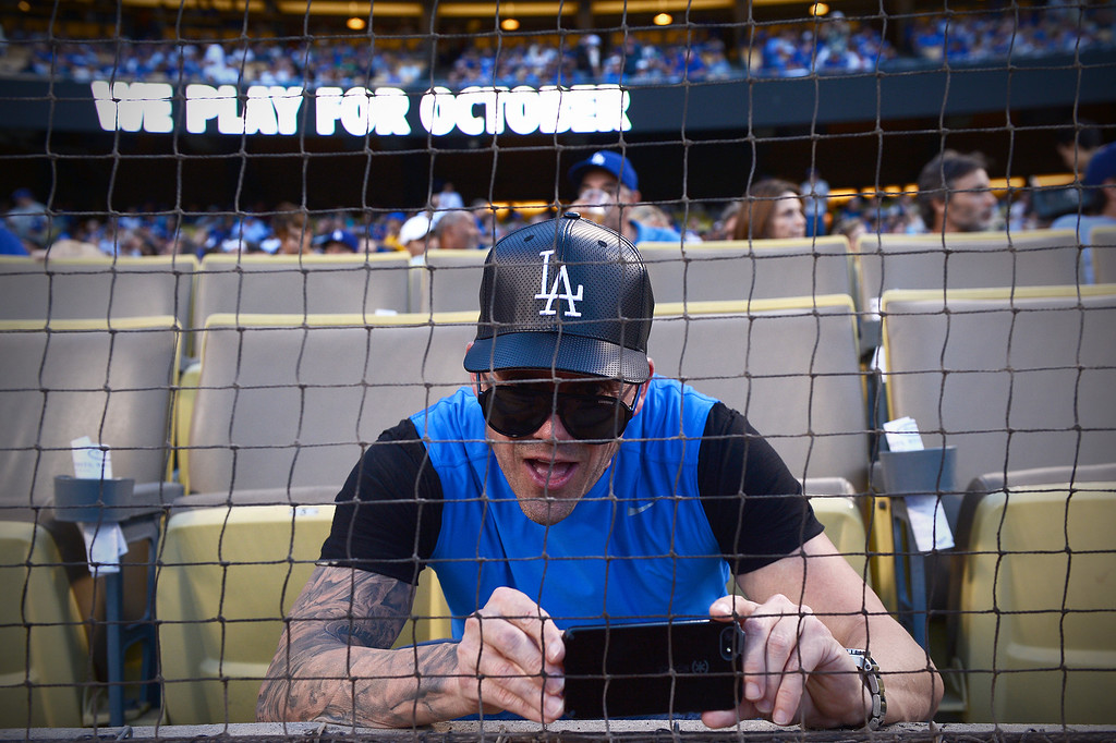 Description of . A fan films the field before Los Angeles Dodgers play the Atlanta Braves during game 4 of the NLDS at Dodger Stadium Monday, October 7, 2013. (Photo by Sarah Reingewirtz/Los Angeles Daily News)