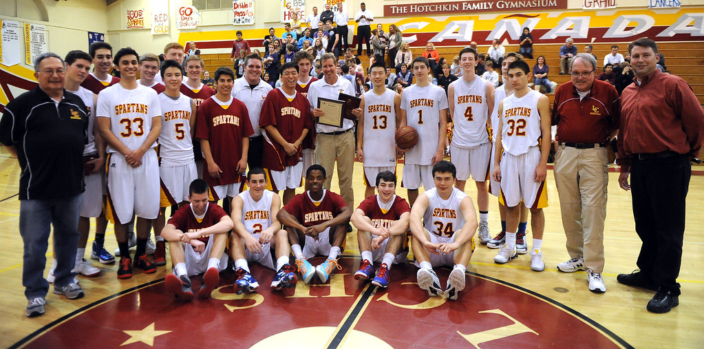 Description of . La Canada head coach Tom Hofman with his team after winning his 600th game as they defeated La Salle 73-62 during a prep basketball game at La Canada High School in La Canada, Calif., on Friday, Jan. 10, 2014. Hofman record is 600 wins and 186 losses since becoming varsity head coach in the 1986-87 season. (Keith Birmingham Pasadena Star-News)