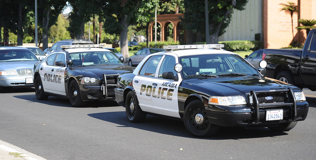Description of . Arcadia Police units sits in front after a lockdown at Arcadia High School in Arcadia, Calif. on Thursday, Sept. 12, 2013.   (Photo by Keith Birmingham/Pasadena Star-News)