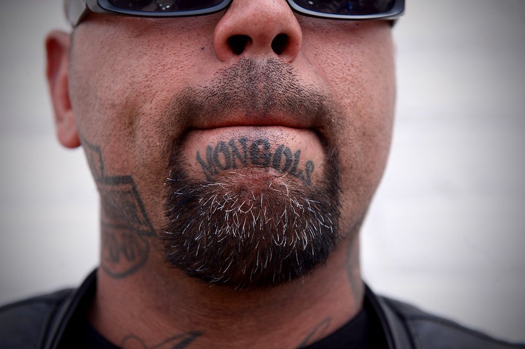 Description of . Mongol Bibi, of Riverside, shows his club name as motorcycle club members rally Saturday, March 29, 2013 at The House Lounge in Maywood in support of the Mongols who are facing a federal trial seeking to take away their trademark patch. (Photo by Sarah Reingewirtz/Pasadena Star-News)