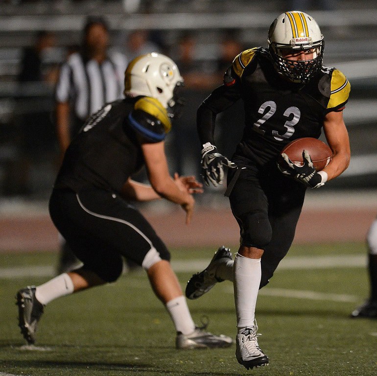Description of . Bassett's Jesus Navarrete (23) runs for yardage against Duarte in the first half of a prep football game at Bassett High School in La Puente, Calif., on Friday, Nov. 1, 2013.    (Keith Birmingham Pasadena Star-News)
