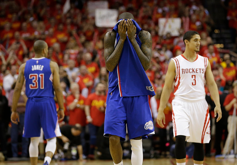 Los Angeles Clippers' Jamal Crawford covers his face as he walks down the court in the closing seconds of the second half in Game 7 of the NBA basketball Western Conference semifinals against the Houston Rockets Sunday, May 17, 2015, in Houston. The Rockets won 113-100. (AP Photo/David J. Phillip)