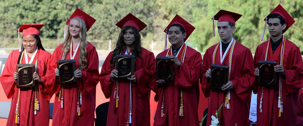 Description of . Valedictorians Carlos Flores, right, Aaron Peretz, second from right, and Daniel Rivera, third from right, with Jasmine Hernandez, third from left, Katherine Winans, second from left, and Elizabeth Woo, left, during the Whittier High School graduation at Whittier College in Whittier, Calif., on Wednesday, June 4, 2014.  (Keith Birmingham/Pasadena Star-News)