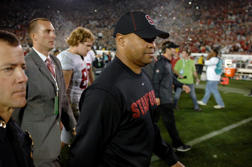 Description of . Stanford head coach David Shaw walks off the field after losing to Michigan State 24-20 at the Rose Bowl, Wednesday, January 1, 2014. (Photo by Michael Owen Baker/L.A. Daily News)