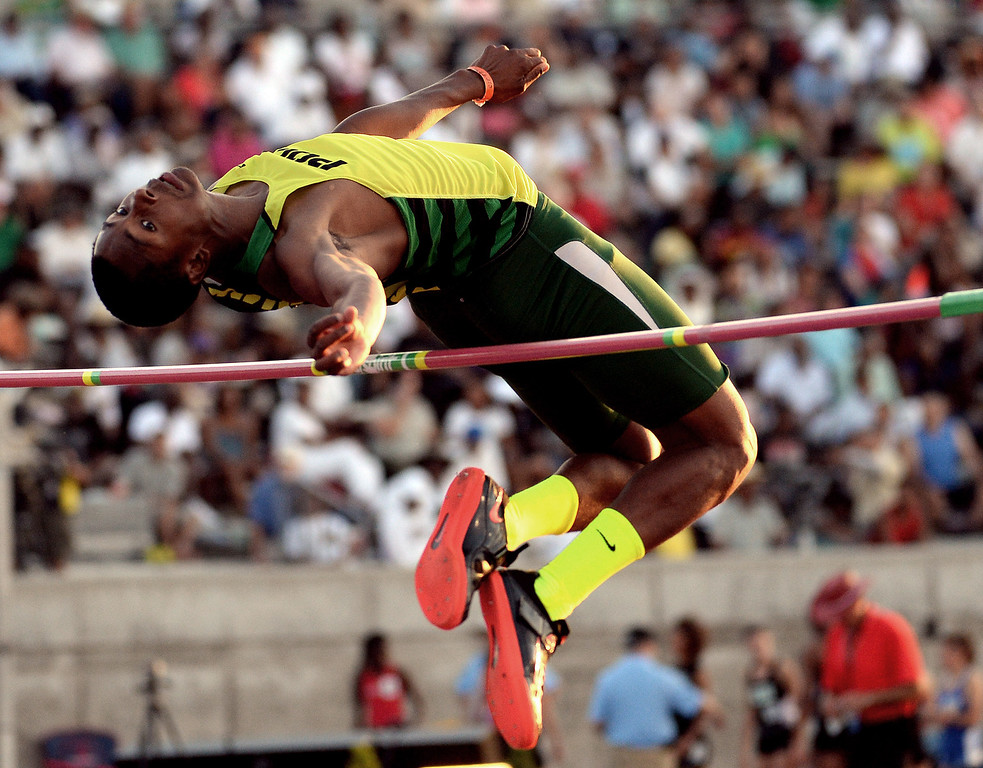 Description of . Long Beach Poly's Vincent Calhoun competes in the pole vault during the CIF California State Track & Field Championships at Veteran's Memorial Stadium on the campus of Buchanan High School in Clovis, Calif., on Saturday, June 7, 2014.   (Keith Birmingham/Pasadena Star-News)