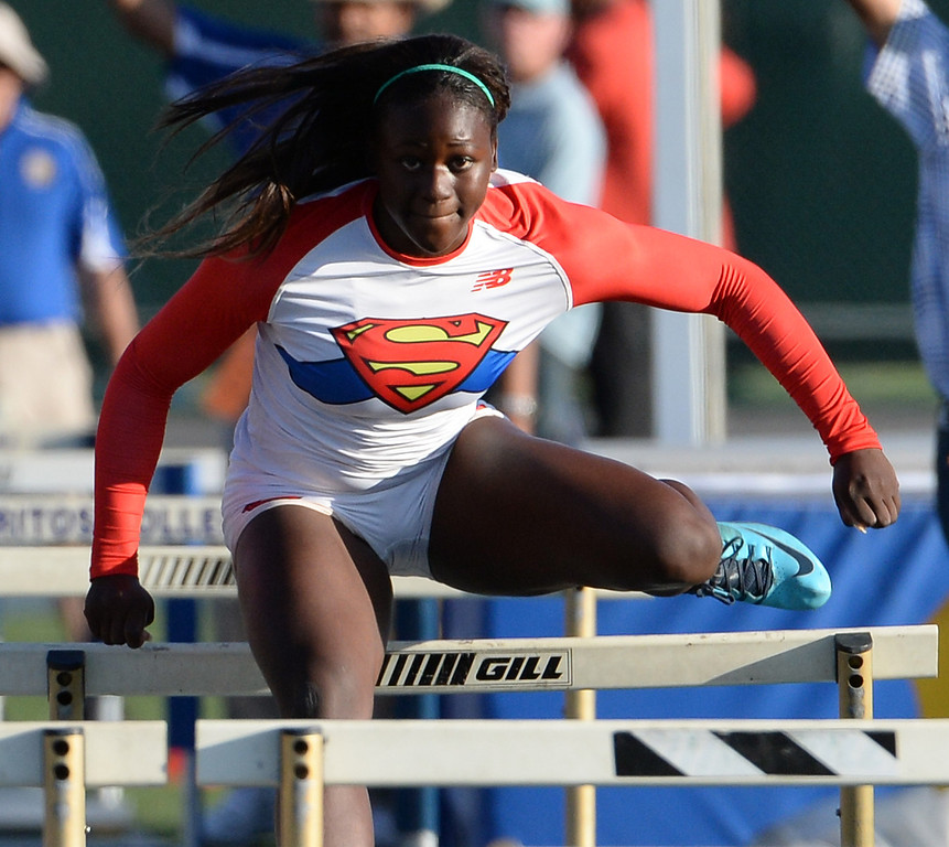 Description of . Serra's Jeanette Paul competes in the 100 meter hurdles during the CIF-SS Masters Track and Field meet at Falcon Field on the campus of Cerritos College in Norwalk, Calif., on Friday, May 30, 2014.   (Keith Birmingham/Pasadena Star-News)