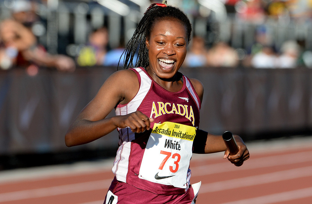 Description of . Arcadia's Kyra White is all smiles as Arcadia wins the 4x200 meter relay seeded during the Arcadia Invitational track and field meet at Arcadia High School in Arcadia, Calif., on Friday, April 11, 2014.  (Keith Birmingham Pasadena Star-News)