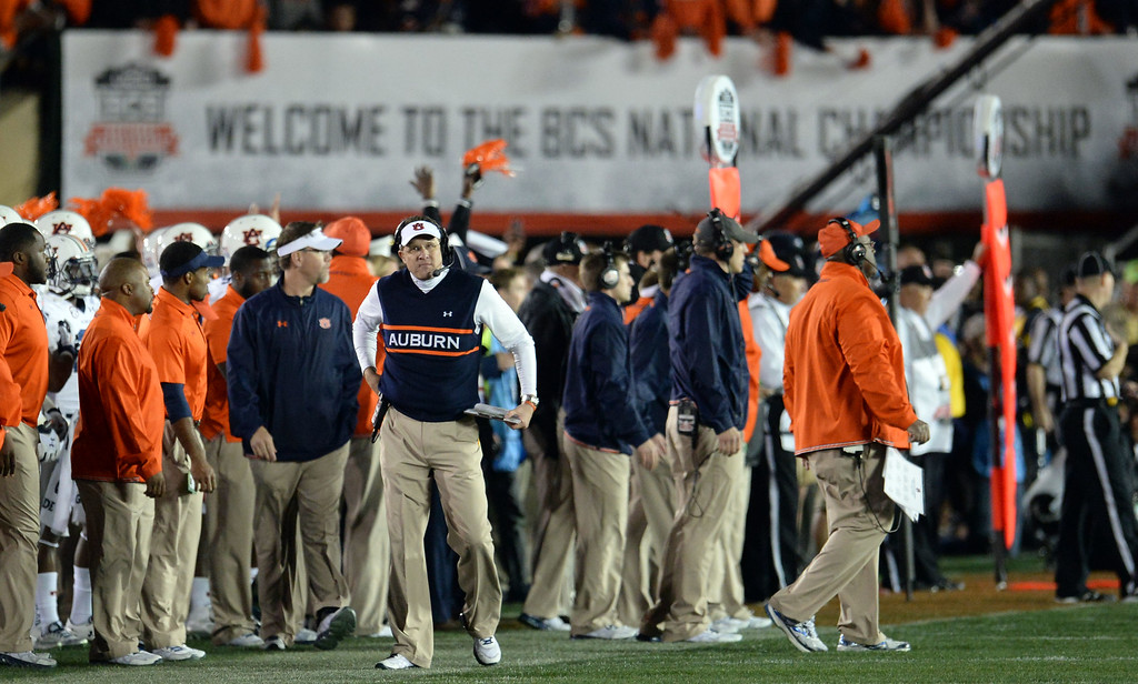 Description of . Auburn head coach Gus Malzahn looks towards the score board as Florida State wins 34-31 during the BCS National Championship game at the Rose Bowl in Pasadena, Calif., on Monday, Jan. 6, 2014. Florida State won 34-31.