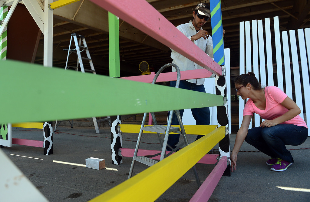 Description of . Tony and Ela Tejeda, of Pasadena, construct a stand for their business Jubee's Ice Cream & Treats in preparation for the L.A. County Fair Tuesday, August 27, 2013, at Fairplex in Pomona. Jennifer Cappuccio Maher/Staff Photographer