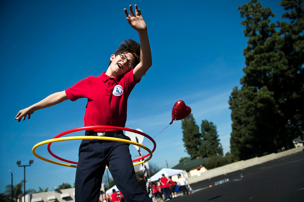 Description of . Tristan Swav, 9, spins Hula-Hoops during an exercise at Plymouth Christian School in Whittier on Friday, Feb. 14, 2014. The school held the exercise event to promote good health. (Photo by Watchara Phomicinda/ Whittier Daily News)