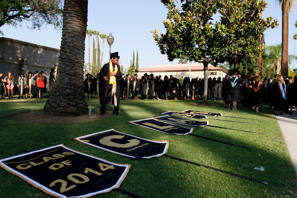 Description of . Citrus Valley High School graduation ceremony takes place on Wednesday, June 11, 2014 at the Redlands Bowl in Redlands, Ca.  (Photo by Micah Escamilla/Redlands Daily Facts)