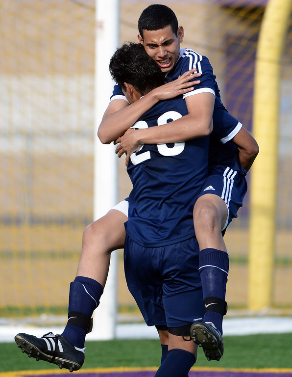 Description of . Baldwin Park's Daniel Penate jumps into the arms of Danny Vega (20) after Vega scores on a penalty kick in the first half of a CIF-SS quarterfinal prep playoff soccer match against Diamond Bar at Diamond Bar High School in Diamond Bar, Calif., on Thursday, Feb.27, 2014. Baldwin Park won 2-1. (Keith Birmingham Pasadena Star-News)