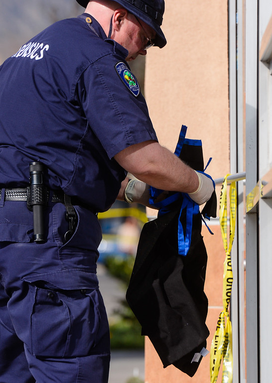 Description of . Police investigate the scene of a homicide that took place inside Domino's Pizza on the 1600 block of E. Highland Avenue in San Bernardino, CA on Wednesday, Feb. 12, 2014. The female victim, who was a worker at Domino's Pizza, was pronounced dead at the hospital, according to authorities. (Photo by Rachel Luna / San Bernardino Sun)