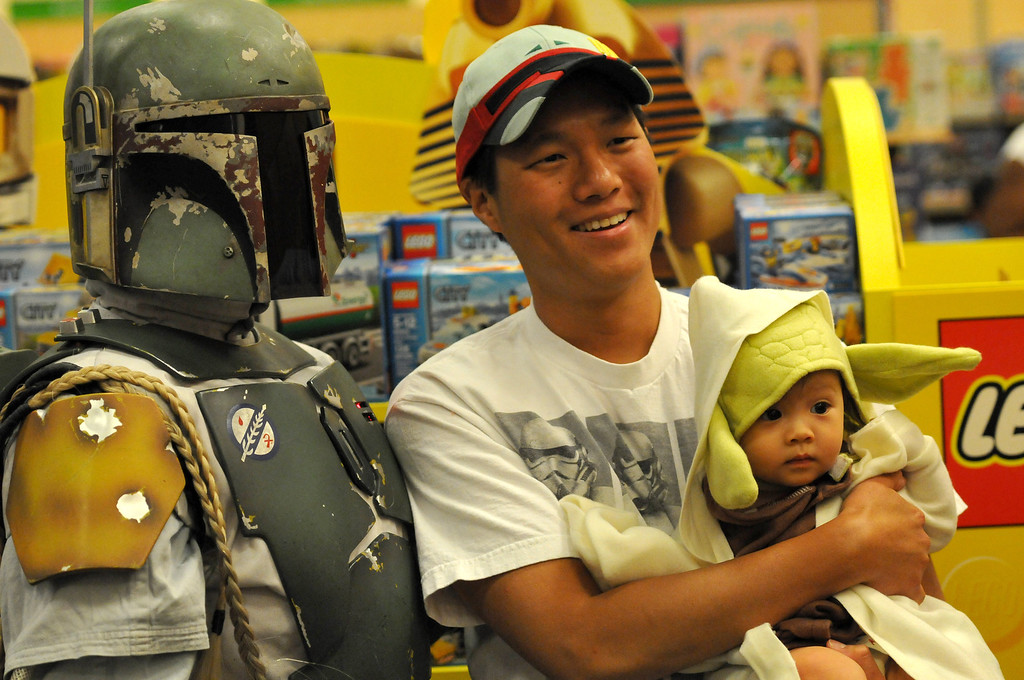Description of . (John Valenzuela/Staff Photographer) David Chang of Redlands and daughter Samantha, poses for a photo with Boba Fett at Barnes & Noble Bookstore in Redlands during the Star Wars Reads Day, Saturday, Oct. 5, 2013.