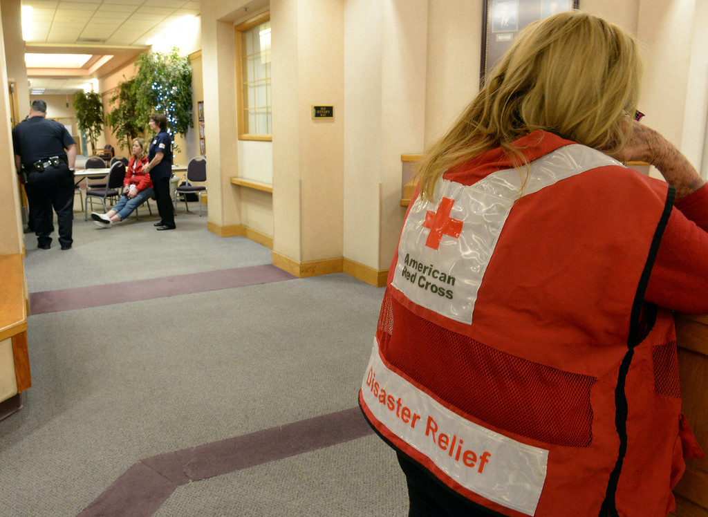 Description of . Red Cross workers check in residents at their overnight shelter at the La Habra Community Center after the 5.1 eartchquake in La Habra on Friday March 28, 2014. (Staff Photo by Keith Durflinger/Whittier Daily News)