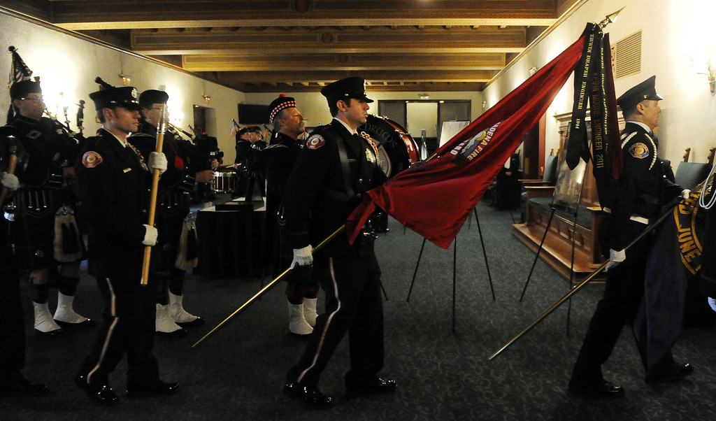 Description of . Color guard makes their way into the auditorium during a celebration of life service for former Pasadena Fire dept. Capt. and California State fire marshall, John Tennant at the Pasadena Civic Auditorium in Pasadena, Calif., on Wednesday, Feb. 5, 2014. (Keith Birmingham Pasadena Star-News)