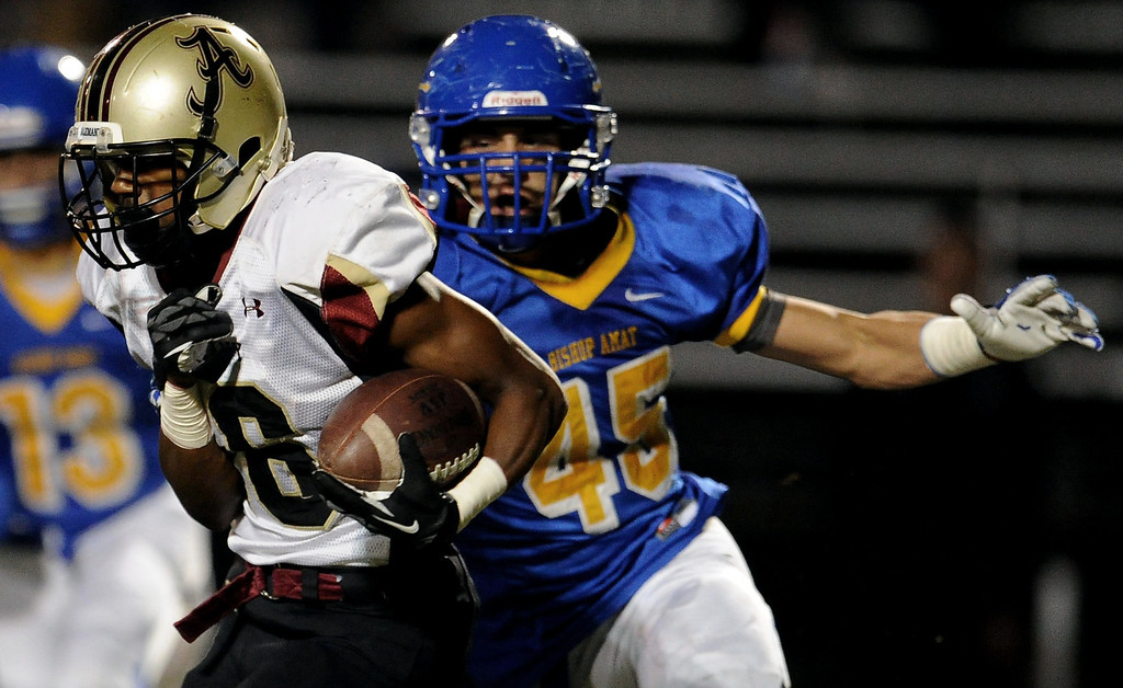 Description of . Alemany's Dominic Bush (6) runs for a first down past Bishop Amat's Christian Wiley (45) in the first half of a prep football game at Bishop Amat High School in La Puente, Calif., on Friday, Oct. 25, 2013.    (Keith Birmingham Pasadena Star-News)
