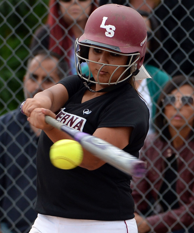 Description of . La Serna's Mel Madrigal singles in the second inning of a prep playoff softball game against Bishop Amat at Bishop Amat High School in La Puente, Calif., on Thursday, May 22, 2014. La Serna won 6-0.   (Keith Birmingham/Pasadena Star-News)