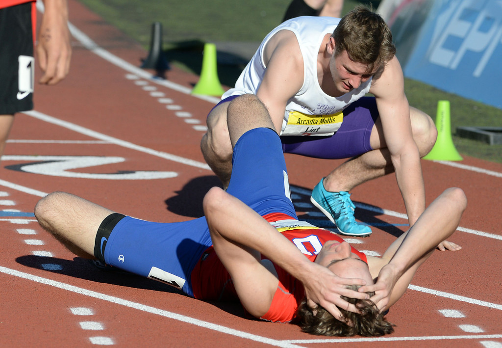 Description of . Athletes break down after a long race during the Arcadia Invitational track and field meet at Arcadia High School in Arcadia, Calif., on Friday, April 11, 2014.  (Keith Birmingham Pasadena Star-News)