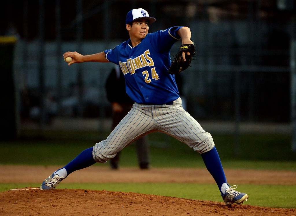 Description of . San Dimas starting pitcher Peter Lambert (C) throws to the plate against Bonita in the fourth inning of a prep baseball game at Bonita High School in La Verne, Calif., on Wednesday, March 19, 2014.  (Keith Birmingham Pasadena Star-News)