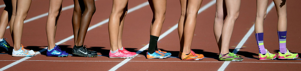 Description of . Athletes prepare for the 4x800 meter relay invitational race during the Arcadia Invitational track and field meet at Arcadia High School in Arcadia, Calif., on Friday, April 11, 2014.  (Keith Birmingham Pasadena Star-News)