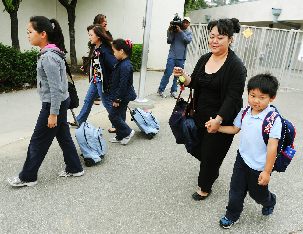 Description of . Children being released with their parents after Brightwood School in Monterey Park, lockdown was cancelled. A 19-year-old man was arrested for allegedly making phone calls to the California Highway Patrol threatening gun violence against local schools on Thursday, May 16, 2013. When the suspect called to make the threat, he said he was en route to a college in Monterey Park, she said. The call was made from a cell phone and was received from the East Los Angeles and Monterey Park areas, officials said.About 14 schools were locked down during the incident. At about 9:30 a.m., Santa Monica Community College police arrested a suspect, a 19-year old male in connection with this threat as well as the Santa Monica threat,