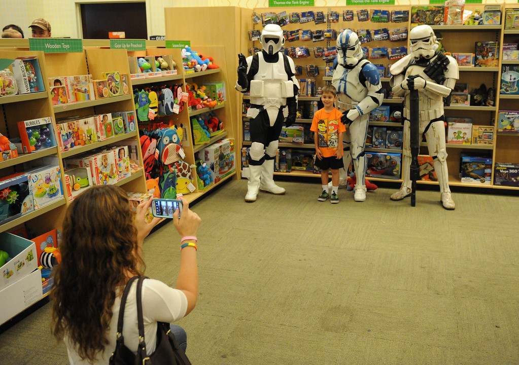 Description of . (John Valenzuela/Staff Photographer)  Barnes & Noble Bookstore in Redlands hosted a Star Wars Reads Day on Saturday, Oct. 5, 2013. Members of 501st Stormtroopers were their posing for photos and signing autographs for Star Wars fans young and old.