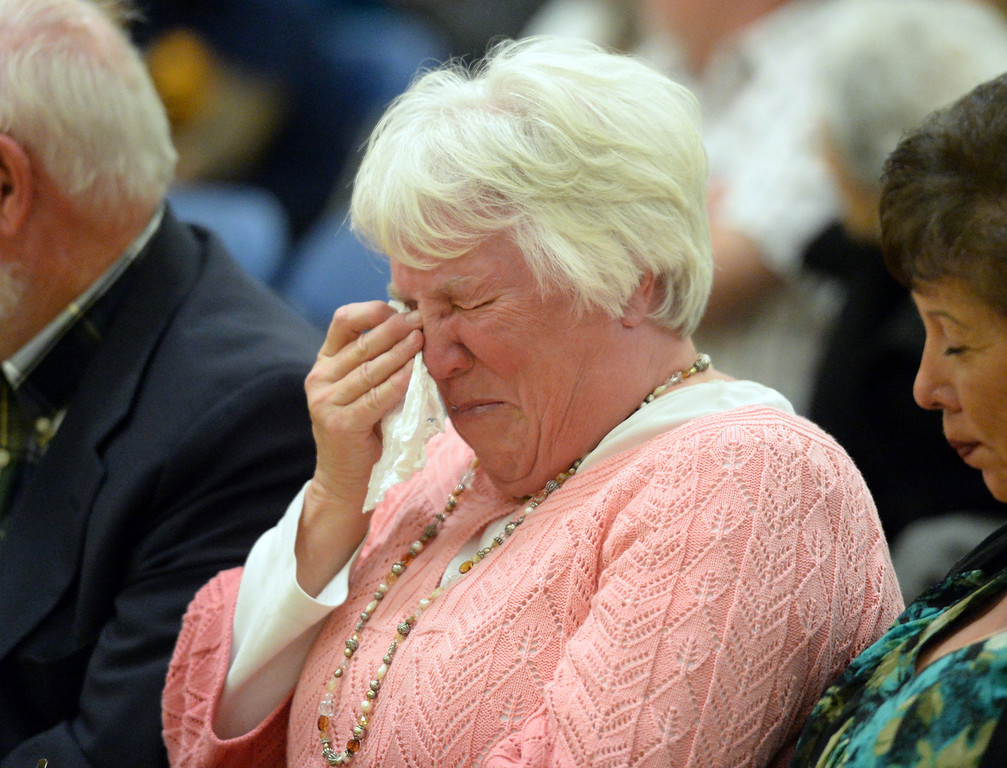 Description of . Penny Levens wipes away tears during the memorial event for her brother, Tim Keeler, in the California High School gym in Whittier on Friday April 4, 2014. Students and friends wrote their notes and memories on a larger poster that said
