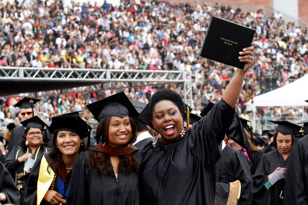 Description of . Graduates during the California State University, Los Angeles, Sixty-Sixth Graduate and Undergraduate Commencement Ceremony, at California State University Athletic Stadium, in Los Angeles, Saturday, June 15, 2013. (Correspondent Photo by James Carbone/SXCITY)