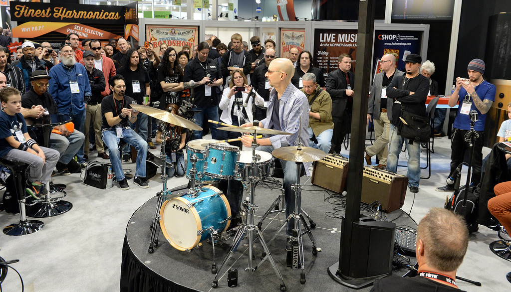 Description of . Rock drummer Steve Smith performs in the Sonor drum booth during The NAMM (National Association of Music Merchants) Show, the world wide music trade show, at the Anaheim Convention Center in Anaheim on Friday January 24, 2014. NAMM is a music trade show drawing retailers and other industry people to Anaheim for four days of everything music. (Staff Photo by Keith Durflinger/San Gabriel Valley Tribune)