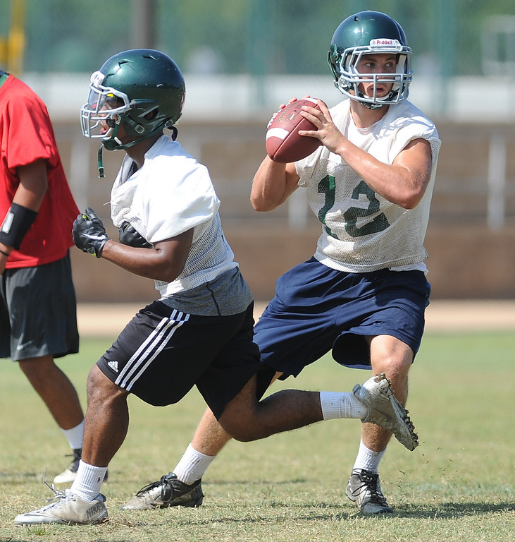 Description of . QB/RB Adam Goss (12) during morning practice at South Hills High School on Friday, Aug. 9, 2013 in West Covina, Calif.   (Keith Birmingham/Pasadena Star-News)