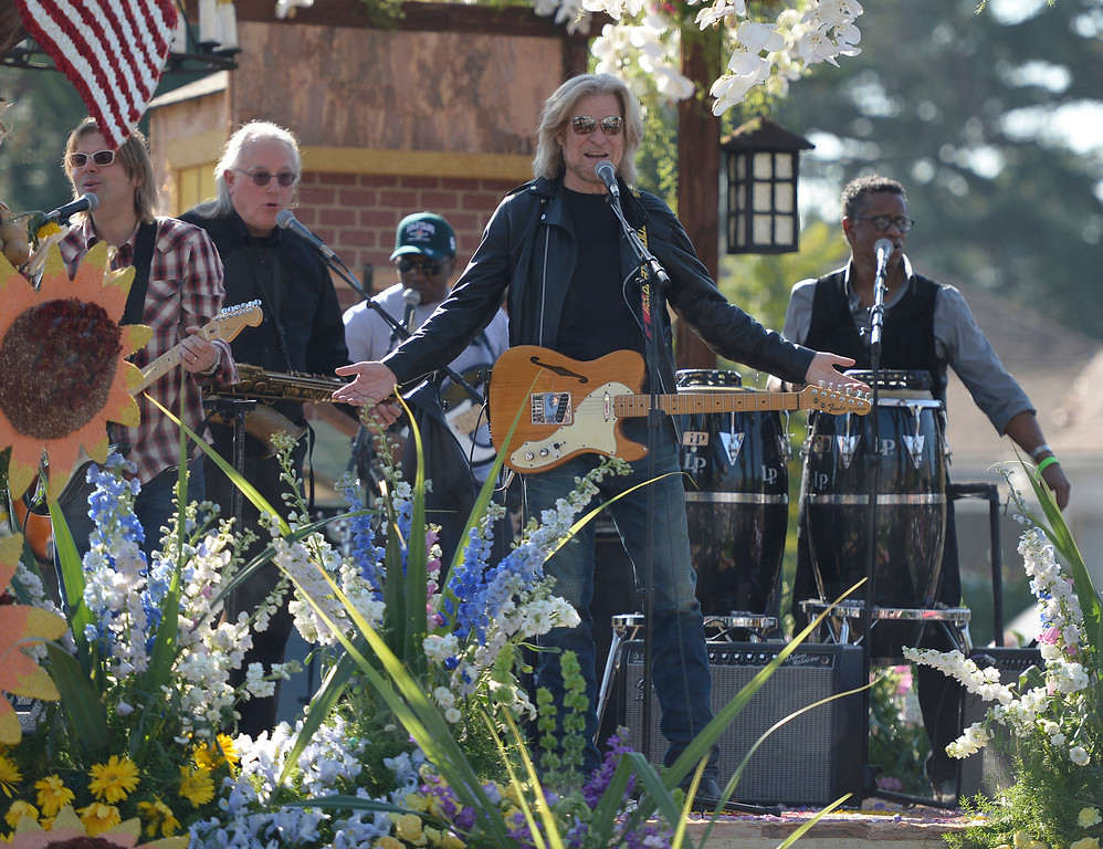 Description of . Daryl Hall sings on one of the floats near the end of the parade route during the 2014 Rose Parade in Pasadena, CA January 1, 2014.(John McCoy/Los Angeles Daily News)