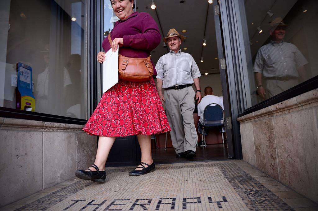 Description of . Graciela and Francisco Alvarez, of Altadena, leave Cover LA Health Insurance Enrollment Shop in Paseo Colorado in Pasadena after getting help with Graciela's application for Covered California Thursday, February 20, 2014. Cover LA opened to help people sign up for health care insurance under the Affordable Care Act. Alvarez, who is retired and on Medicare, canceled his 57-year-old wife's insurance after applying in the exchange last November and has since found out his wife is not covered. (Photo by Sarah Reingewirtz/Pasadena Star-News)