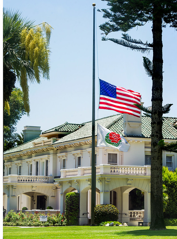 Description of . Officials at the Tournament House lowered the American Flag and Rose Parade Flag to half-mask because of the passing of Louis Zamperini, war hero, Olympic distance runner, 2015 Rose Parade grand marshal, who has died at age 97. (Photo by Walt Mancini/Pasadena Star-News)