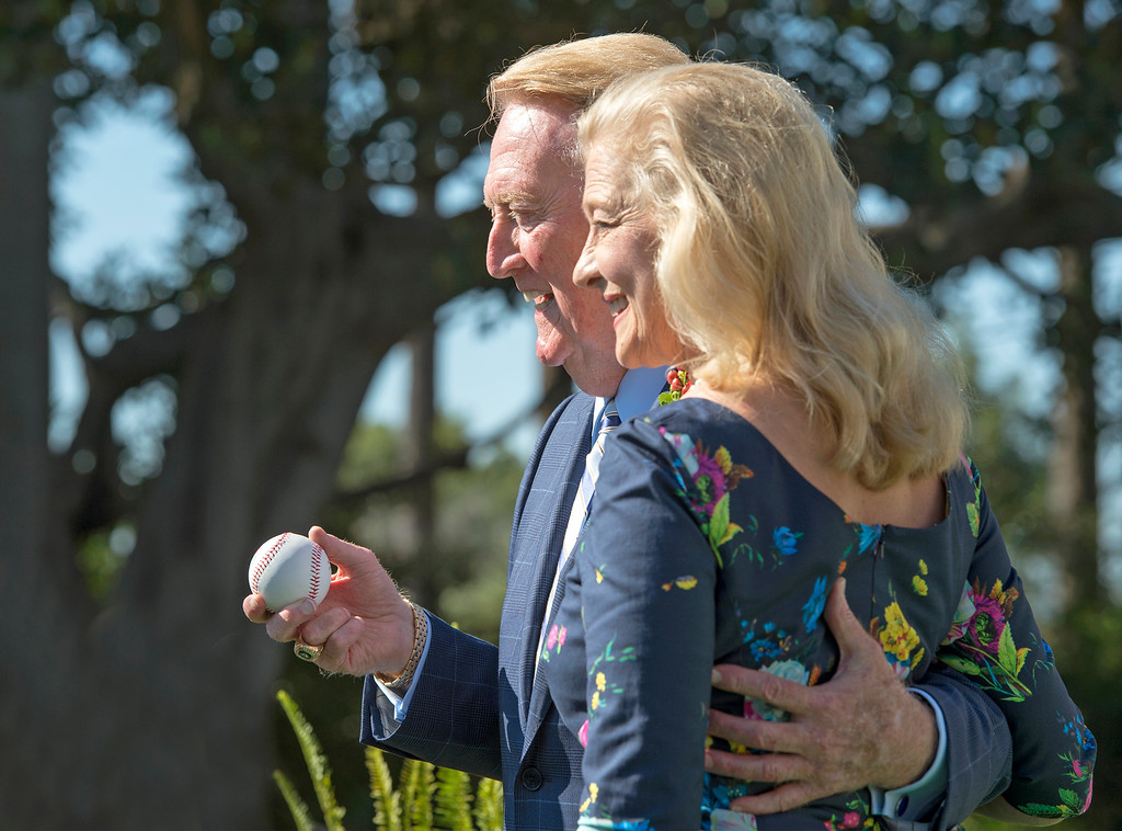 Description of . Iconic Los Angeles Dodgers broadcaster Vin Scully, posing for photos with wife Sandi Scully, has been named as 2014 Tournament of Roses Grand Marshal the Pasadena, Calif. Tournament House Sept. 5, 2013.   (Staff photo by Leo Jarzomb/Pasadena Star-News)