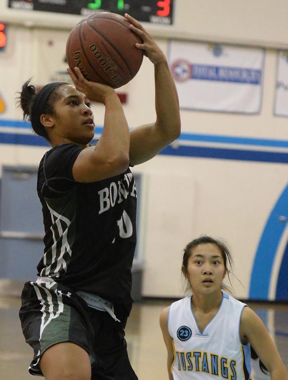 Description of . Bonita's Nikki Wheatley (C) (10) drives to the basket against Walnut in the first half of a prep basketball game at Walnut High School in Walnut, Calif., on Wednesday, Jan. 15, 2014. Bonita won 60-50. (Keith Birmingham Pasadena Star-News)
