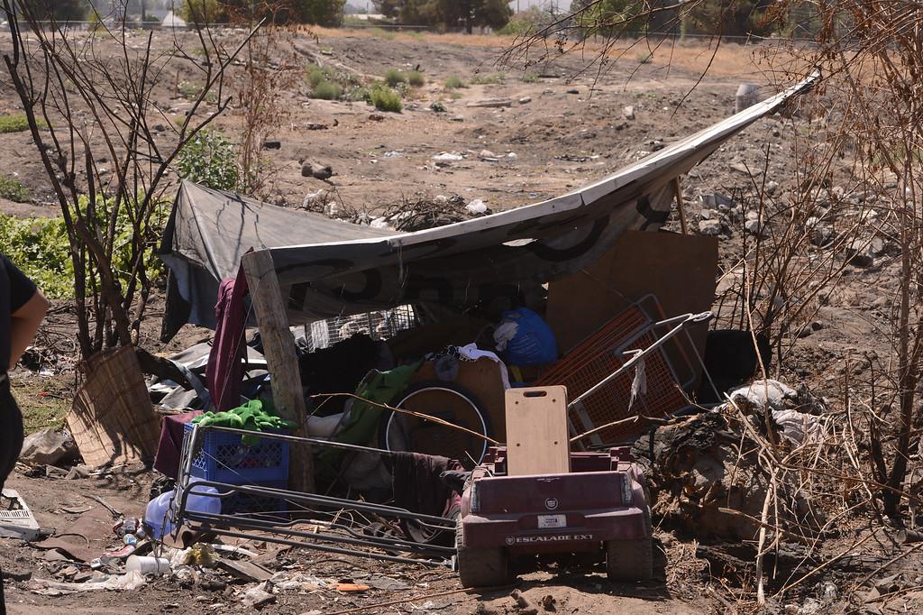 Description of . A view of a homeless camp as seen in a vacant lot along Ninth Street in San Bernardino August 14, 2013. GABREL LUIS ACOSTA/STAFF PHOTOGRAPHER.