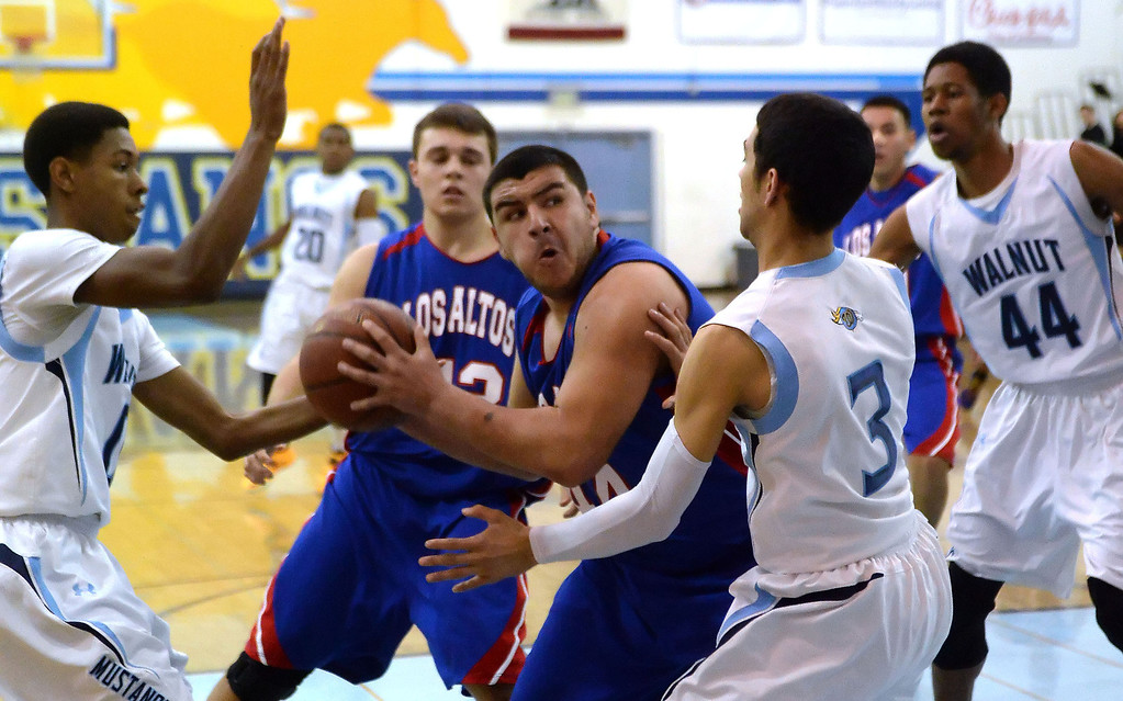 Description of . Los Altos' Jayson Jones (44) drives to the basket against Walnut in the first half of a prep basketball game at Walnut High School in Walnut, Calif., on Wednesday, Jan. 22, 2014. (Keith Birmingham Pasadena Star-News)