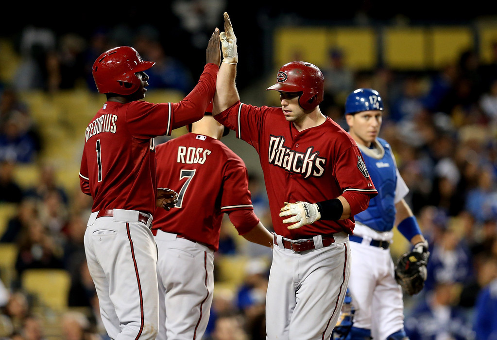 Description of . Paul Goldschmidt #44 and Didi Gregorius #1 of the Arizona Diamondbacks celebrate after both score on Goldschmidt's two run home run in the sixth inning against the Los Angeles Dodgers at Dodger Stadium on May 8, 2013 in Los Angeles, California.  Diamondbacks win 3-2.  (Photo by Stephen Dunn/Getty Images)