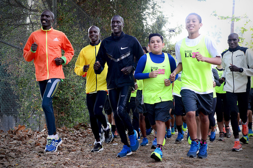 Description of . Elite marathon runners visit with students, who are going to run in Sunday's LA Marathon and are part of Students Run LA, at Griffith Park in Los Angeles as the elite runners train Friday, March 7, 2014 for the LA Marathon. (Photo by Sarah Reingewirtz/Pasadena Star-News)