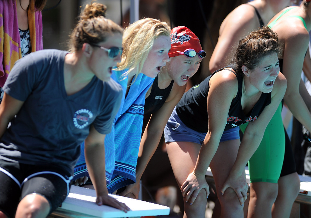 Description of . Swimmers cheer during the 500 freestyle race during the CIF-SS Division II swim finals at Riverside City College on Saturday, May 11, 2013 in Riverside, Calif.  (Keith Birmingham Pasadena Star-News)