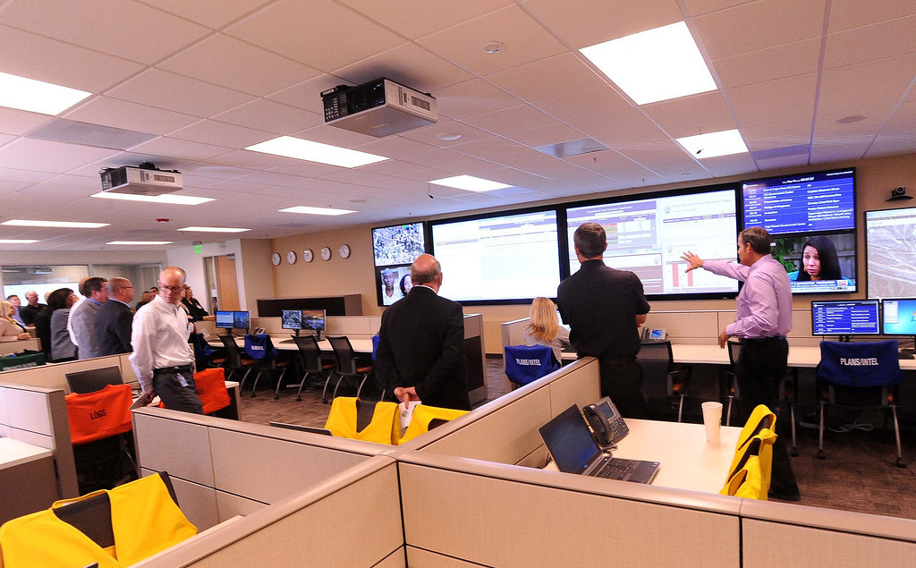 Description of . Emergency Services Manager Michael Antonucci, right, gives a tour of the Emergency Operations Center at the High Desert Public Safety Operations Center in Hesperia May 10, 2013.   GABRIEL LUIS ACOSTA/STAFF PHOTOGRAPHER.