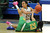 Bishop Amat's Jennifer Vasquez (24) scrambles for the loose ball with Long Beach Poly's Arica Carter (23) in the second half of a CIF State Southern California Regional semifinal basketball game at Bishop Amat High School on Tuesday, March 12, 2013 in La Puente, Calif. Long Beach Poly won 52-34. 