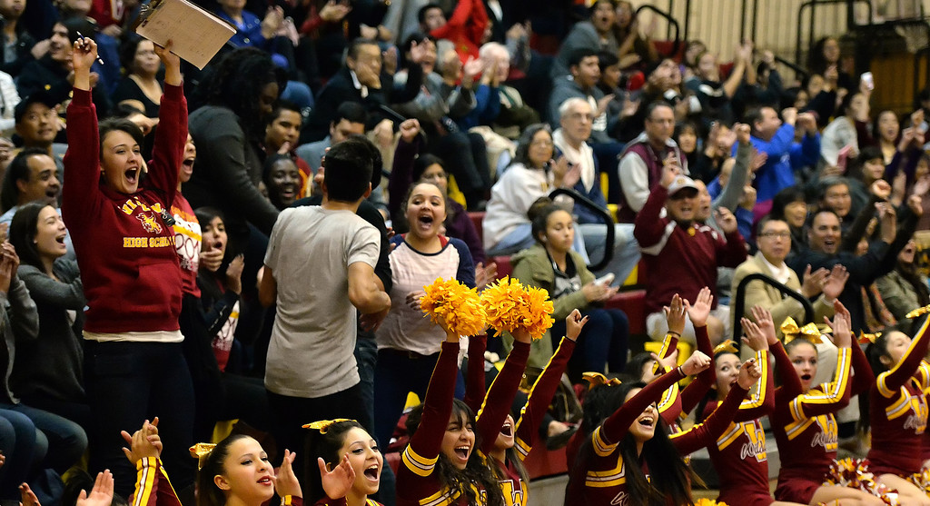 Description of . Wilson fans react after a three pointer in the first half of a prep basketball game against San Dimas at Wilson High School in Hacienda Heights, Calif., on Friday, Jan. 31, 2014. (Keith Birmingham Pasadena Star-News)