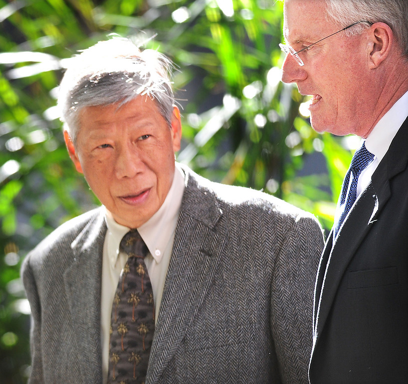 Description of . Irwindale Finance Director Abe DeDios with his attorney Daniel Nixon, outside of Clara Shortridge Foltz Criminal Justice Center. Former Irwindale Councilwoman Rosemary Ramirez,  Councilman, Manuel Garcia,  Mayor Mark Breceda, and Finance Director Abe DeDios were with their attorneys at Clara Shortridge Foltz Criminal Justice Center Thursday, February 27, 2014.  Irwindale officials are accused of misappropriation of public funds, conflict of interest and embezzlement spending $200,000 on trips to New York City between 2001-2005.  Their arraignment was postponed once again to April 9, 2014.(Photo by Walt Mancini/San Gabriel Valley Tribune)