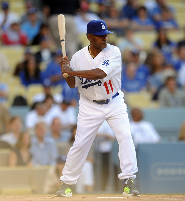 Description of . Former Los Angeles Dodgers Manny Mota during the Old-Timers game prior to a baseball game between the Atlanta Braves and the Los Angeles Dodgers on Saturday, June 8, 2013 in Los Angeles.   (Keith Birmingham/Pasadena Star-News)