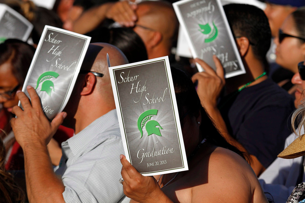 Description of . Guests shade themseleves during Schurr High School 2013 Commencement Exercises, at Ken Davis Field, at Schurr High School in Montebello, Thursday, June 20, 2013. (Correspondent Photo by James Carbone/SWCITY)