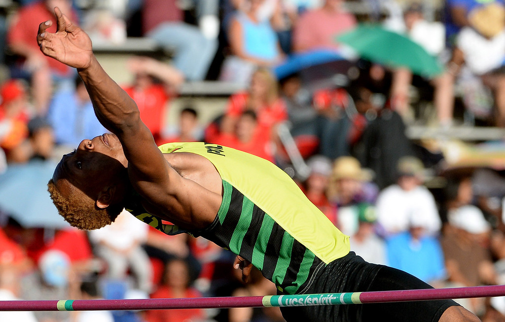 Description of . Long Beach Poly's LaBrice Howard competes in the high jump during the CIF-SS Masters Track and Field meet at Falcon Field on the campus of Cerritos College in Norwalk, Calif., on Friday, May 30, 2014.   (Keith Birmingham/Pasadena Star-News)