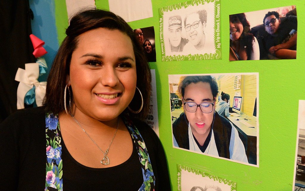 Description of . Transgender student, Staceyy Holidayy, 15, formerly Roberto Valencia, who received a two-day suspension on Wednesday for a dress code violation at El Rancho High School in Pico Rivera, Calif., stands next to photos of herself last year on Friday January 10, 2014. Holidayy, formerly Roberto Valencia, was told that she was not allowed to use the girl's restroom but had to use the restroom in the nurses office. (Staff Photo by Keith Durflinger/Whittier Daily News)
