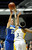 Agoura #15 Kim Jacobs shoots over Gahr #3 Jewlyn Sawyer. Agoura defeated Gahr 60-39 in the CIF-SS Division III-AAA Girls Basketball Championship at the Anaheim Convention Center in Anaheim, CA 2/23/2013(John McCoy/Staff Photographer)
